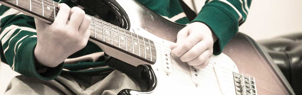 header-boy-guitar
